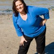 Stock Photo: Plus Sized Fitness- Stretch on Beach