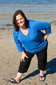 Plus Sized Fitness- Stretch on Beach — Stock Photo