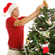 Decorating Christmas Tree - Placing Angel — Stock Photo