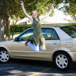 Teen With Car Jumps for Joy — Stock Photo