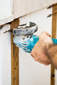 Cutting Insulation with Grinder — Stock Photo