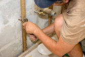 Plumber Working with Pliers — Stock Photo