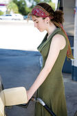 Teen Pumping Gas — Stock Photo