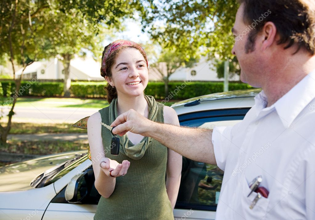 Young woman being handed the car keys by her father or driving instructor. — Stock Photo #6717914