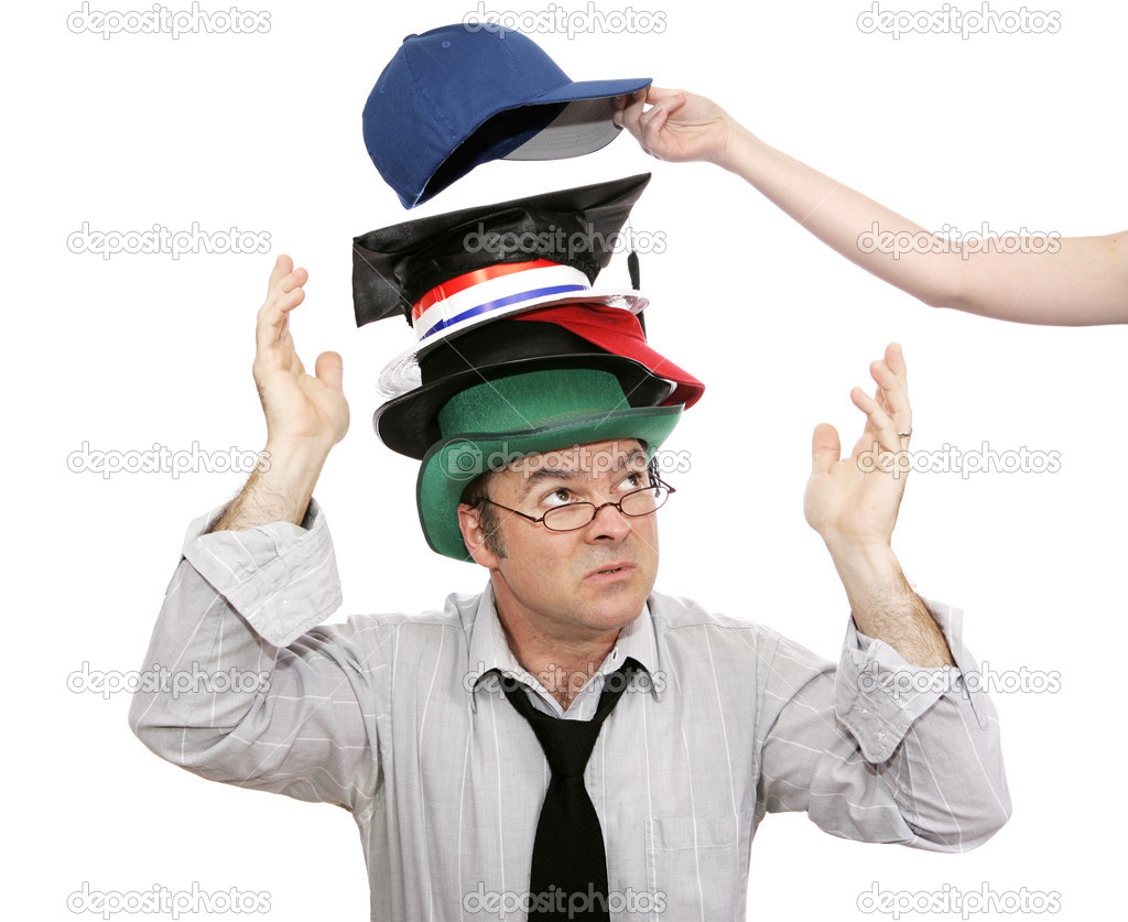 Overwhelmed businessman with more and more responsibility - represented by hats.  Another being added.   — Stock Photo #6717973