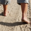 Bare feet in sand. — Stock Photo #6619140