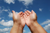 Hands of young woman in prayer to heaven. — Stock Photo