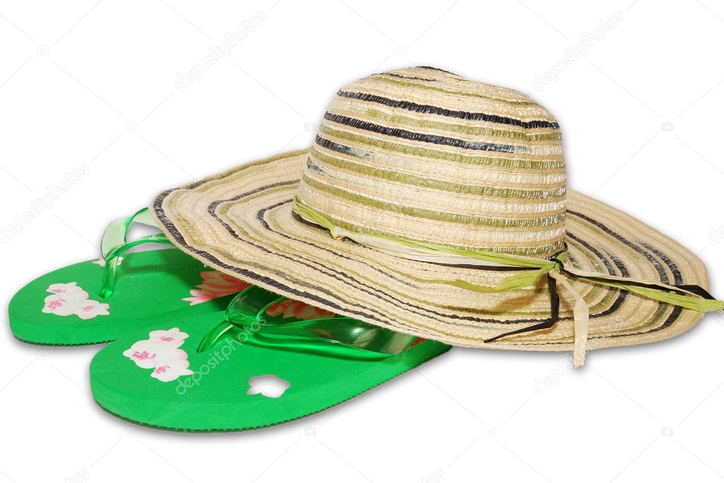 Sun hat, sunglasses and flip-flops on the sand — Stock Photo #6618759