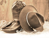 Cowboy boots and hat — Stock Photo