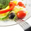 Salad and fork - Stock Photo