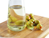 Olives and cooking oil — Stock Photo