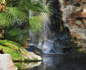 Waterfall in a park — Stock Photo