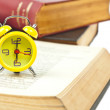 Clock and book as time management concept - Стоковая фотография