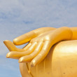 big golden buddha hand statue in thaland temple — Stock Photo