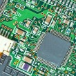The modern printed-circuit board with electronic components macr — ストック写真