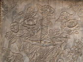 Ancient flower engrave on wall — Stock Photo