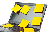 Laptop notebook isolated on white with postits on it — Stock Photo