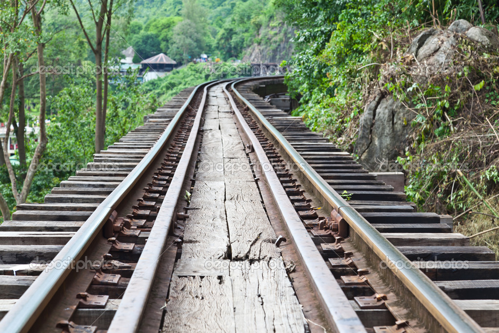Curve train rails with a forest at the background — Stock Photo #6649875