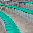 Old plastic green seats on stadium — Stock Photo