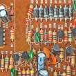 The printed-circuit board with electronic components macro backg — Stockfoto