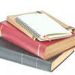Stock Photo: Pencil in, cream colored paper notebook and book as background