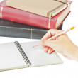 Hand writing with pencil on, cream colored paper notebook and bo — Stock Photo #6655383