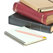 Stock Photo: Pencil on, cream colored paper notebook and book as background