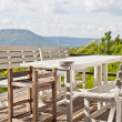 Royalty-Free Stock Photo: Dining table on terrace and, mountain view