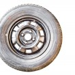 Old Spare wheel on white background — Stock Photo