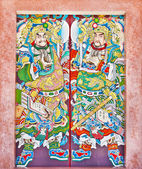 Dekorace dveří chrámu na čínský chrám v thajsku — Stock fotografie