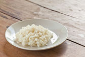 Thai food, jasmine rice cooked on plate, on wood background — Stock Photo