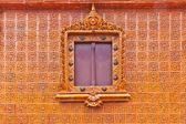 Window on glazed tile background, Thailand temple — Stock Photo