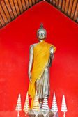 Buddha, stand on red background, Thailand temple — Zdjęcie stockowe