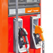 Stock Photo: Several gasoline pump nozzles at petrol station