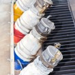Several gasoline pump nozzles at petrol station for transportati — Stock Photo