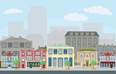 Urban street scene with smart townhouses — Stock Vector