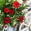 Stock Photo: Wedding Carriage With Huge Bouquet On Side
