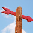Red Arrow On Wodden Signpost — Stock Photo