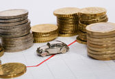 Car Parked Between Stacks Of Coins — Stock Photo