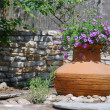 Stock Photo: AmphorUsed As Flowerpot
