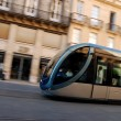 Stock Photo: Fast Moving Tram Through Shopping District Captured With Motionblurr