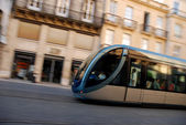 Fast Moving Tram Through Shopping District Captured With Motionblurr — Stock Photo