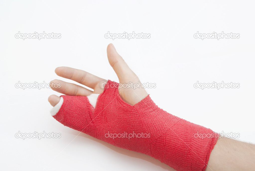 Right hand bandaged in red plaster to support the healing process of broken bone. There is loads of copyspace as the backround is white  Stock Photo #6504852