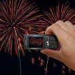 Stock Photo: Mobile Phone With Hand Capturing Firework