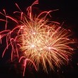 Stock Photo: Yellowish-Red Fireworks At Night
