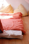 Cosy Bed On Floor With Huge Pillows — Stock Photo