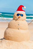 Happy Snowman Enjoying The Sun & The Sea — Stock Photo