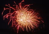 Yellowish-Red Fireworks At Night — Stock Photo