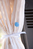 Curtain In Car With Smilie Button — Stock Photo