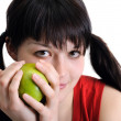 Royalty-Free Stock Photo: Young attractive woman holding green apple